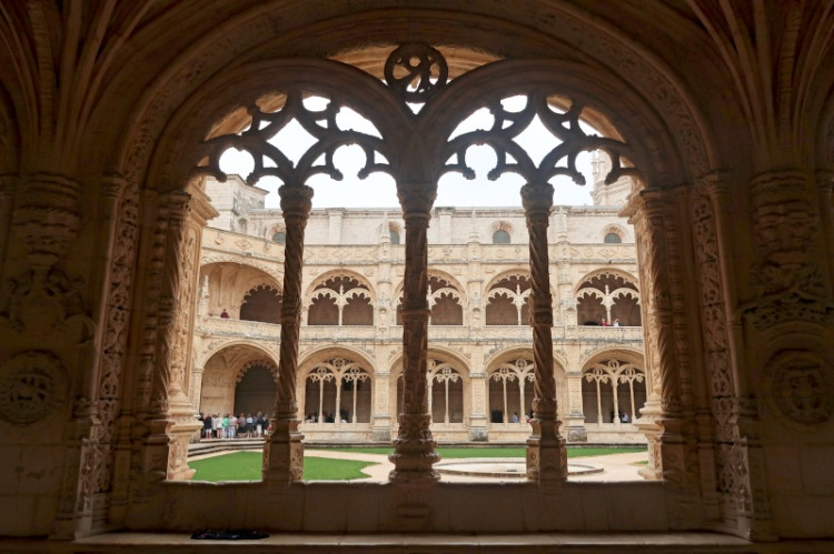 view-through-monastery-window-bars-to-courtyard