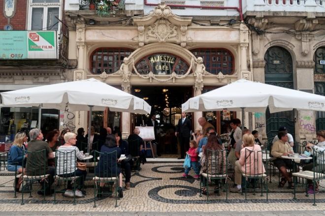 cafe-dwellers-enjoy-streetside-dining-at-majestic-cafe-porto