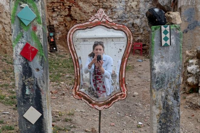 photographer-captures-herself-in-rundown-urban-mirror