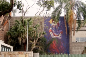 street-art-mural-of-a-defiant-woman-in-sydneys-glebe