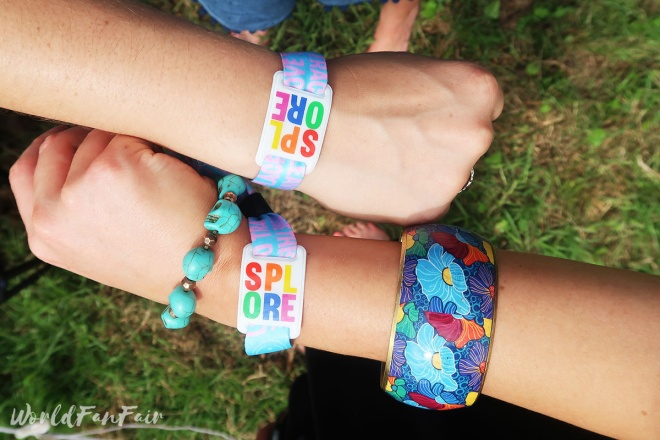 Rainbow Splore wristbands on wrists