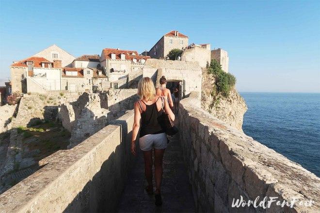 Women walking along the top of the walls