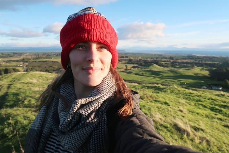 Nikki on Mount Tauhara with grassy hills behind