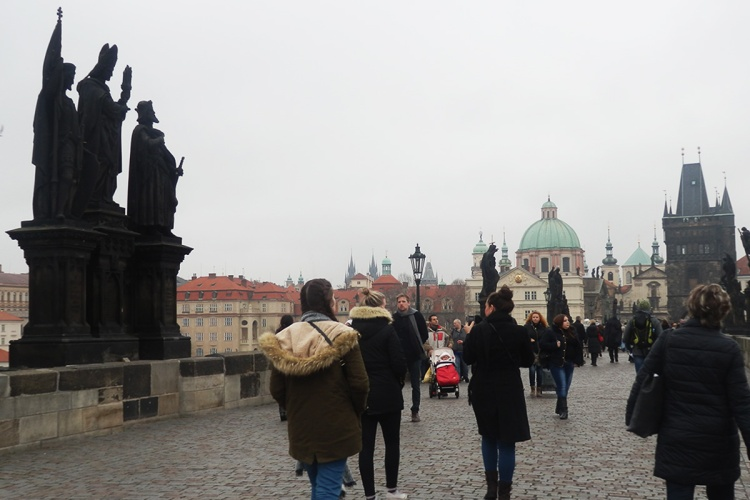 Topdeck tour group crossing Charles Bridge