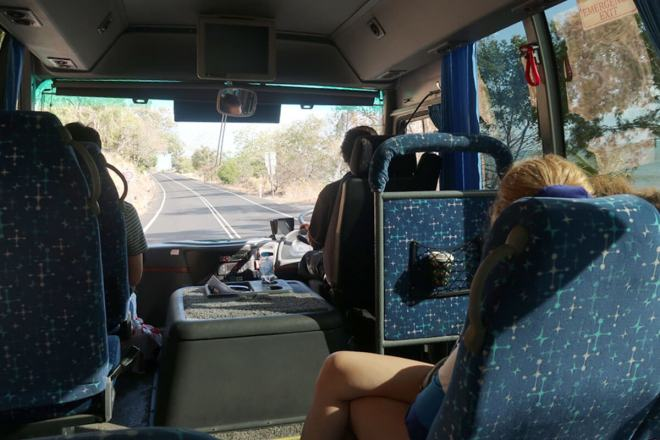 Sitting in the Jungle Tours bus driving along the Cairns coast