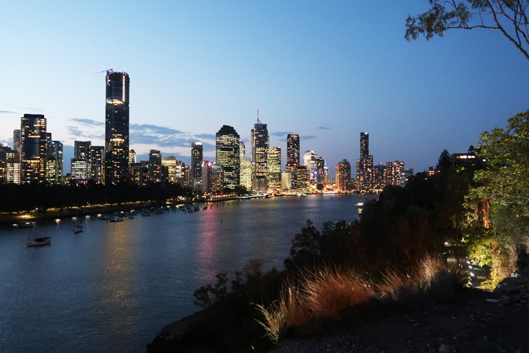 Night falls across Brisbane river and city