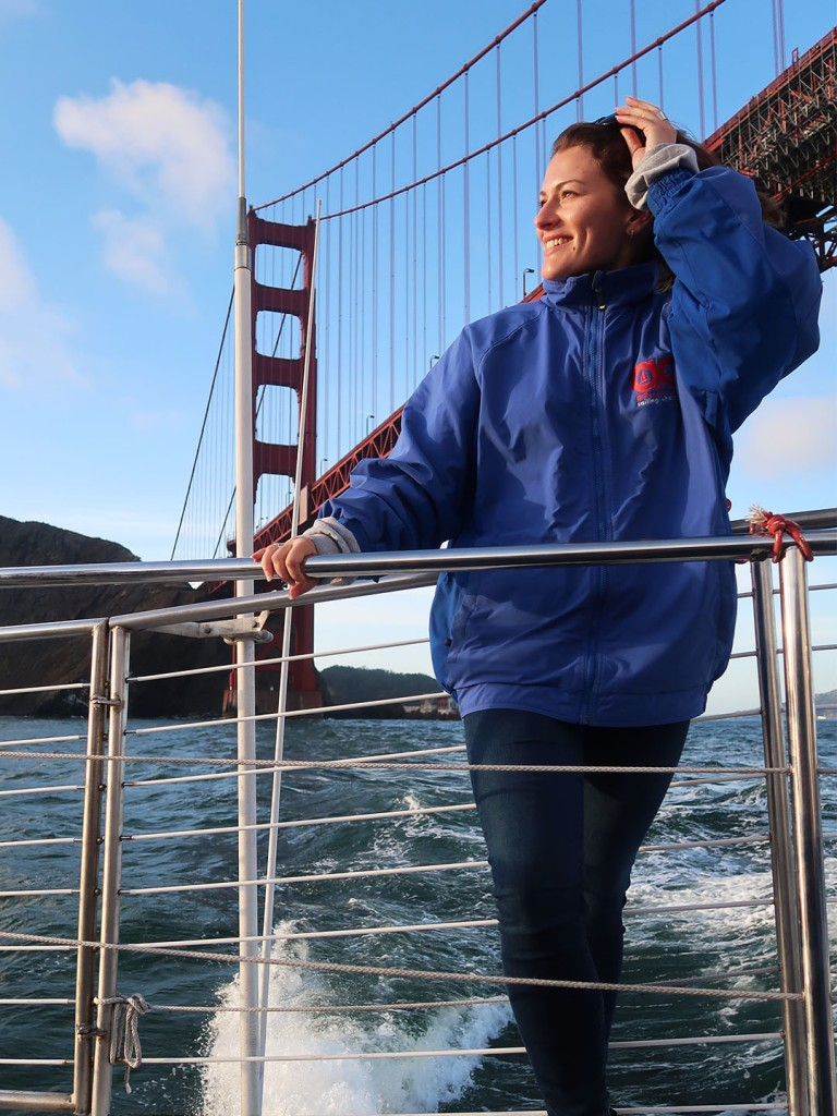 Nikki on sunset sail with Golden Gate Bridge